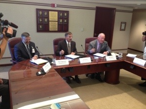 Left: Memorial CEO Mark Vipperman, board President Al Deering and Spectrum CEO Rick Breon sign the agreement.