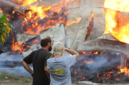 John and Mel Shafer watch as fire destroys the barn.