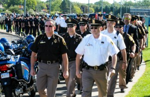 Sheriff Cole, right, and Oceana County Sheriff Bob Farber, left, lead their personnel during Butterfield's funeral.