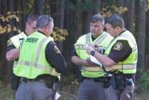 Sheriff Cole, left, talks to deputies.