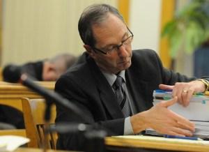 Prosecutor Paul Spaniola looks up information.