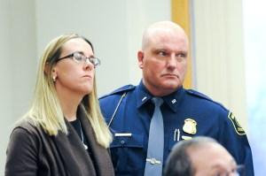 Butterfield's fiance, Jennifer Sielski speaks. With her is Lt. Kevin Leavitt