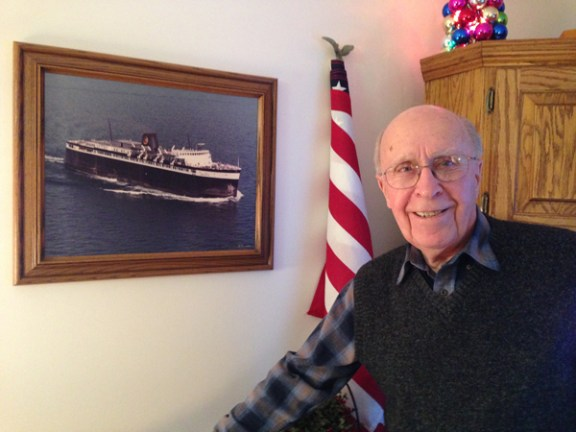 Bill Klemm poses with a picture of the Badger when it was operated by Chessie