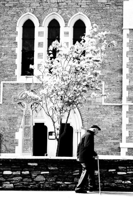 A man walks by a church in Kenmare, Co. Kerry.