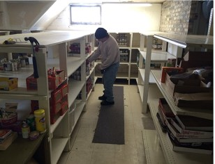 Ed Kyte, Salvation Army food pantry coordinator goes over inventory.  MCP file photo.
