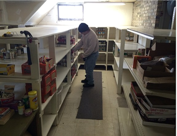 Ed Kyte, Salvation Army food pantry coordinator goes over inventory.