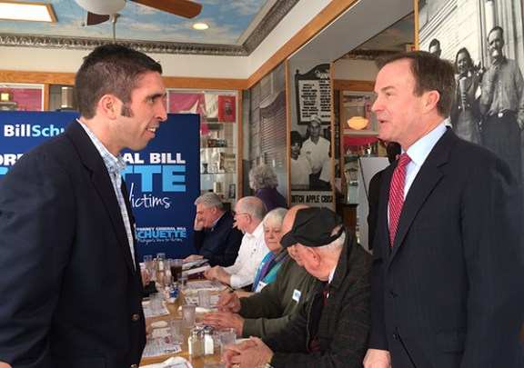 Attorney General Bill Schuette, right, talks with Willie Reed of Ludington Beverage.