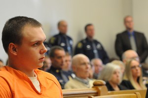 Eric Knysz in court last week. In the background is Paul T. Butterfield, father of Trooper Butterfield.