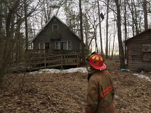 Hamlin Assistant Fire Chief Tom Johnson inspects the house.