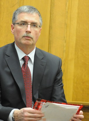 MDOC Inspector Craig Smith with the alleged confession letter.  File photo.