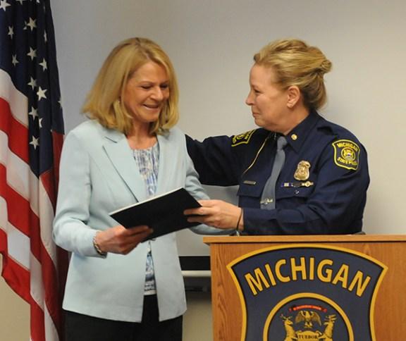 MSP Col. Kriste Kibbey Etue presents Connie Helton with a Distinguished Citizen Award.