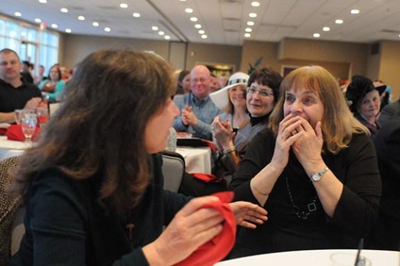 Nancy Supran, left, and Donna Miszewski react to receiving the word.