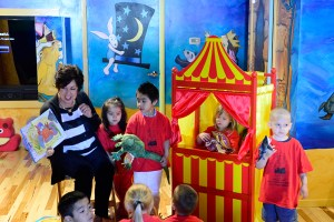 Barbara Sims engages the children in a puppet show.