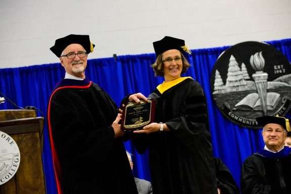 Dr. Charles Dillon, president of WSCC presents Dr. Tanis with the alumni achievement award.