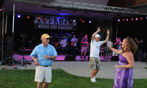Don Klemm and his daughter, Carrie Klemm, dance to the Lou Thunder Band.