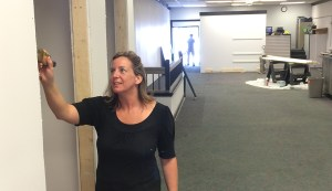 Owner Natalie Wroble paints the new dressing rooms.