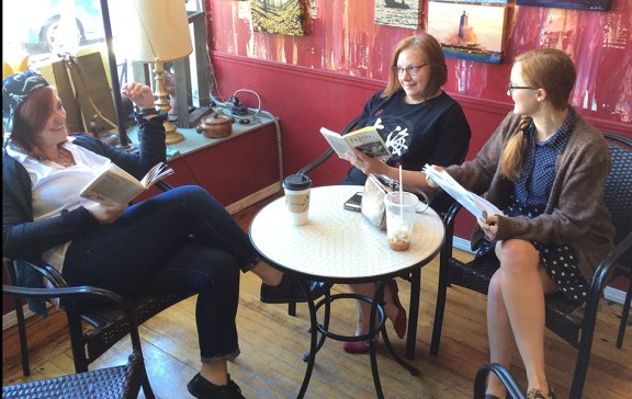 The trio practices their lines at Redolencia Coffee Shop in downtown Ludington. Clockwise, from left, is Brigette, Nancy and Kathleen.