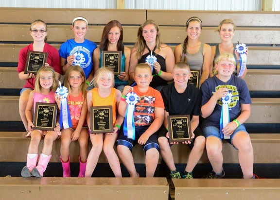 Large animal sweepstakes winners. In front, from left: Autum Weidus, champion 5-6-year-olds; Jessica Petersen, reserve 5-6; Brianna Crawford, champion 7-8; Logan Stakenas, reserve 7-8; Ryan Crawford, champion beginner; Anna Campbell, reserve beginner. In back, from left: Audra Shoop, champion intermediate; Samantha Wilkosz, reserve intermediate; Faith Whitaker, champion jr.; Brooke Lee, reserve jr.; Amy Grace Shoop, champion sr.; Devan Lindeman, reserve sr.