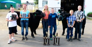 From left: Mikey Lammi, champion rate of gain; Faith Whitaker, reserve champion; Paige Whitaker, reserve grand champion, market steer; Eli Shoup, champion homegrown; Preston Kelley, reserve homegrown.