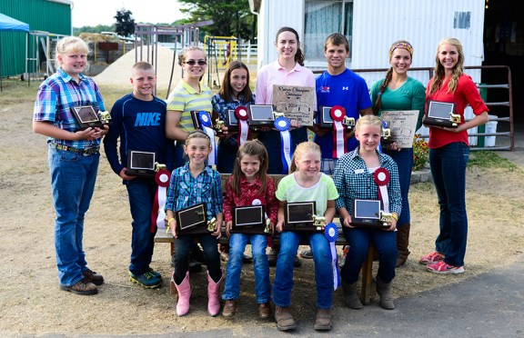 Sheep showmanship. Seated, from left: Lucy Shoup, 1st place open youth, 5-6; Kasey Gaudette, 2nd place open youth 5-6; Brianna Crawford, 1st place open youth 7-8; Ella Korendyke, 2nd place open youth 7-8. In back, from left: Anna Tyndall, 1st beginner; Ryan Crawford, 2nd beginner; Audra Shoop, 1st intermediate; Racehl Doyle, 2nd intermediate; Stephanie Doyle, 1st jr. and reserve supreme; Jacob Shoop, 2nd jr.; Amy Grace Shoop, 1st place senior supreme; Madison Geers, 2nd place sr.