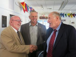Pentwater Service Club President Bill Maxwell, State Rep. Jon Bumstead, and Roseman.