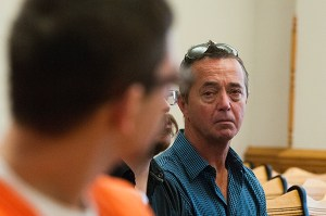 Scott Dumas looks at Keith Blackburn while Scott's wife Kathy speaks to the court.