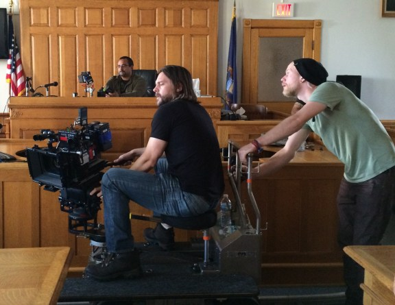 Director Jon Gunn checks out the camera angle inside the courtroom at Mason County Courthouse Saturday.