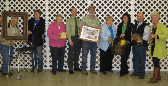 Pictured here with unique items are left to right: Howard Vanderlaan, Julie Knodel, Connie Hartley, Scott Shoup, John Newton, Mary White, Nancy Sanford, Mark Watts and Diane Watts.