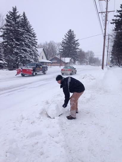 Steve Gates shovels the end of his grandparents' driveway on State Street in Hart Friday morning. Gates, who lives in White Pigeon near Kalamazoo, is visiting his grandparents, Gene and Barb Schaner.