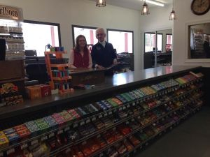 Cashiers Angie Aspy and Chuck McKinney greet Wishing Well customers with friendly smiles.