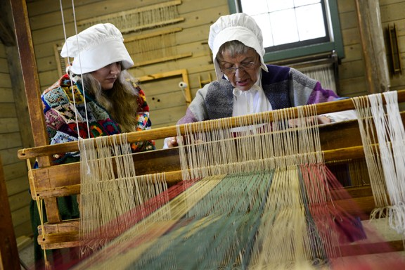 Anne Pettigrew shows Mary Fruk of White Pine Village how to weave.