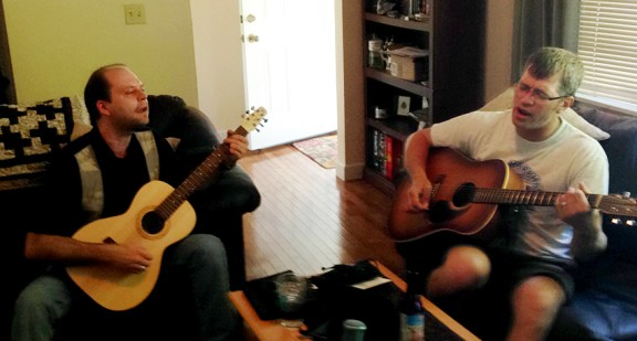 Dave Kosla, left, and Adam Knudsen, jam at Adam's house during Kate's interview.