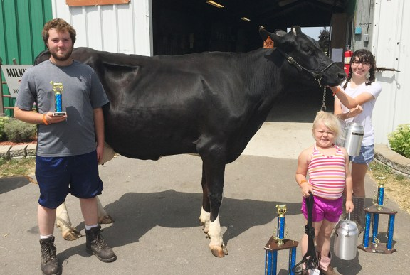 From left: Trent Thurow, best udder all breeds; Isabel Babbin, junior champion overall, grand champion Jersey, reserve cow overall; Leah Larsen, grand champion holstein, overall cow.