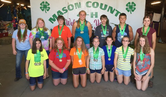 4-H exhibits. Ages 13 and over. First row, from left: Rylee Cregg, Alexis Bendele, Cammie Shoup, Andrea Shoop, Nicole Kaminski, Audra Shoop, Savannah Pohl. Second row, from left: Lorie Gerbers, Linsey Gerbers, Nate Story, Jenny Appledorn, Marc Lane, Jacob Shoop, Amy Grace Shoop.