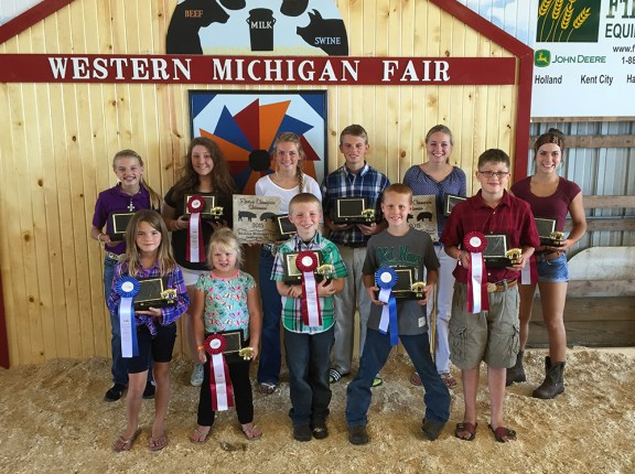 Swine best of show. Front, from left: Jessica Petersen, first place open youth ages 5-6; Isabel Babbin, second place open youth 5-6; Brogan Quillan, second place open youth ages 7-8; Brayden Overmyer, first place beginner; Clayton Hissong, second place beginner. Back, from left: Olivia Flewelling, first place intermediate; Spencer Bowman, second place intermediate; Claire Flewelling, first place junior, reserve supreme; Will Flewelling, second place junior; Madalyn Flewelling, first place senior, supreme showman; Amy Grace Shoop, second place senior. Missing: Jared Petersen, first place open youth 7-8.