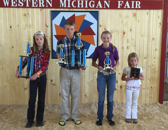 From left: Gabby Jensen, grand campion overall; Will Flewelling, reserve champion overall, champion homegrown; Olivia Flewelling, reserve homegrown; Aiden Wood, reserve rate of gain.