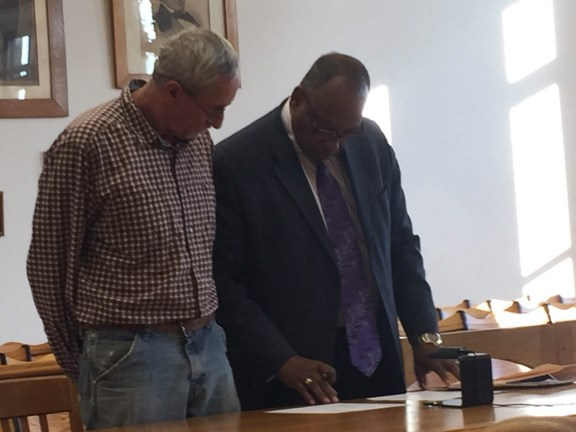 Tribble, at left, a with his attorney, John Beason.