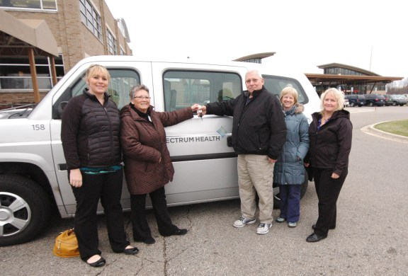 Presenting keys to van-SHLH: Marissa Plouff, wellness coordinator, and Irene Balowski, director of the Susan P. Wheatlake Regional Cancer Center, give the keys to the new van to Larry Lange, volunteer coordinator of the American Cancer Society's Road to Recovery program, Kay Kessel, nurse navigator and Linda Whitman, office manager for Spectrum Health Ludington Hospital Cancer & Hematology.