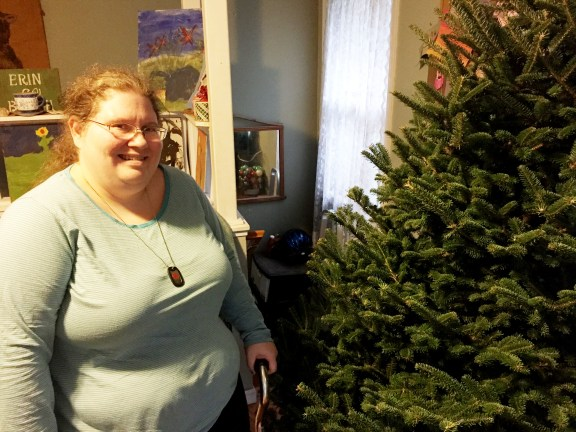 Erin Whitaker with the Chrismas tree that was given to her.