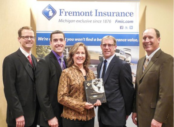 Pictured left to right: Kevin Kaastra from Fremont Insurance, Joe Knowles, Patty Smith and Scott Smith from Smith & Insurance. Brad Roeber from Fremont Insurance.