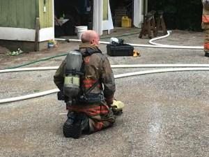 Hamlin firefighter Andy Larr takes a break.