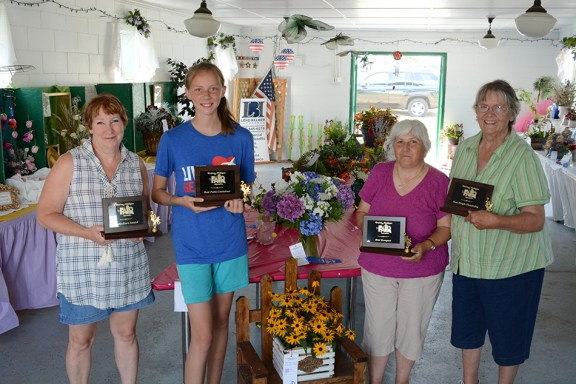 Floriculture: From left: Leann Saxton, floriculture; Abby Leese, best patio container; Patricia Perez, best bouquet; Donna Shoup, best single flower.