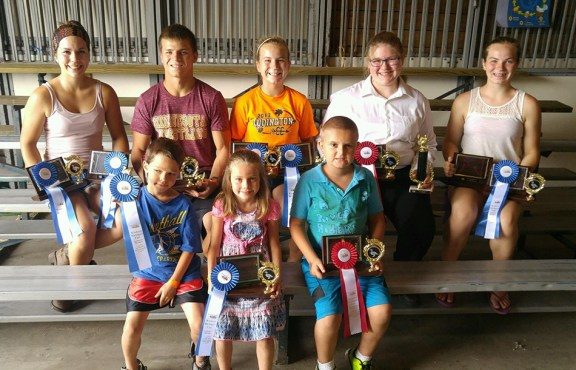 Waterfowl and turkey (two separate categories). Front, from left: 9-10-year-old: Morgan Allen, 1st; 5-6: Chloee Harris, 1st, Mason McBroom, 2nd; Back row: 17-19: AmyGrace Shoop, Jacob Shoop, 2nd; 14-16: Andrea Shoop, 1st, Alexandria Shoop, 2nd; 11-13: Audra Shoop, 1st. Also, pigeon showmanship: 7-8: Henry Malburg, 1st; 5-6: Chloee Harris, 1st.