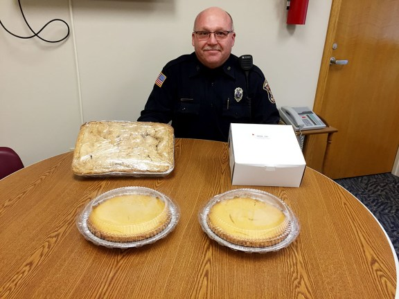 Officer Tony Kuster with some of last year's pies. File Photo.