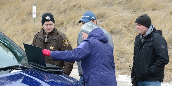 Liz Reimink of Mason County Emergency Management discusses the search with Oceana County Sheriff Craig Mast, left.