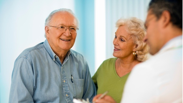 senior couple talking with doctor picture id658152148