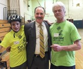 Attorney Marc L. Breakstone with a cyclist and an instructor at the iCan Shine Bike Camp in Arlington last April.