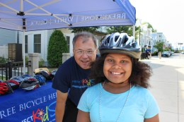 Attorney David White with a young cyclist in South Boston.
