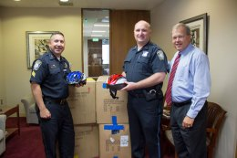 Attorney David W. White with Boston Police Sgt. Gino Provenzano. Boston Police received 150 bicycle helmets from our Project KidSafe campaign. Helmets were distributed at bike rodeos in Dorchester and Hyde Park.