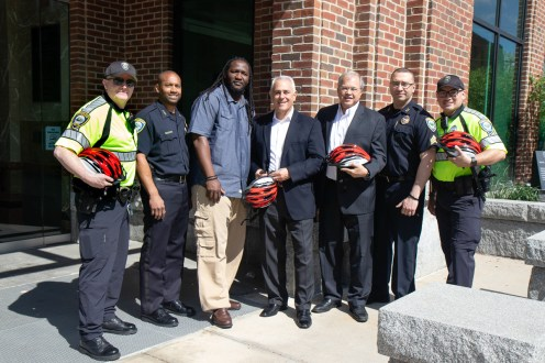 Breakstone, White & Gluck donated bicycle helmets to Cambridge Police Department. Left to right: Officer Matthew Mahoney; Deputy Superintendent Rob Lowe; Kessen Green, the department's director of outreach & community programs; Attorney Ronald E. Gluck; Attorney David W. White; Sgt. Steven Magalhees and Detective Gustavo Lopez.